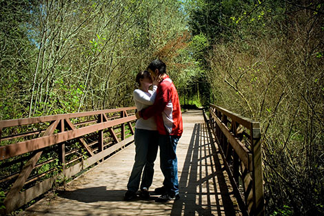 Crossing a bridge, but not before celebrating with a kiss.
